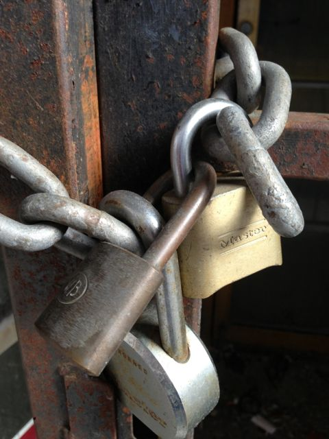 photo of one door with three locks