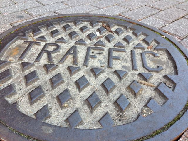 Sewer hole cover labeled Traffic