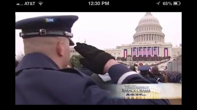 Soldier saluting the White House flags