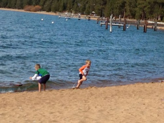 two young boys at Lake Tahoe's public beach in late Spring