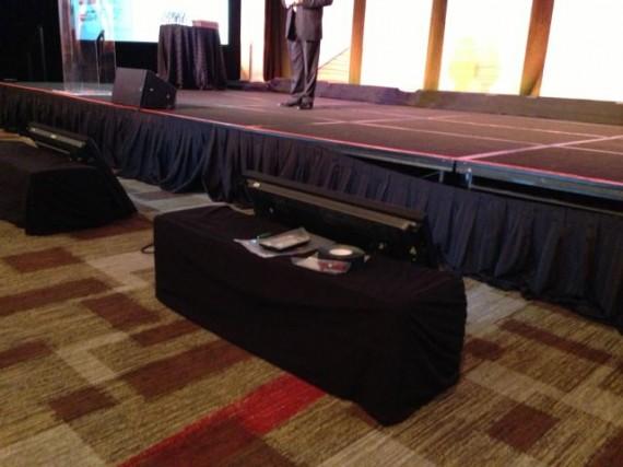 professional speaker rehearsing onstage