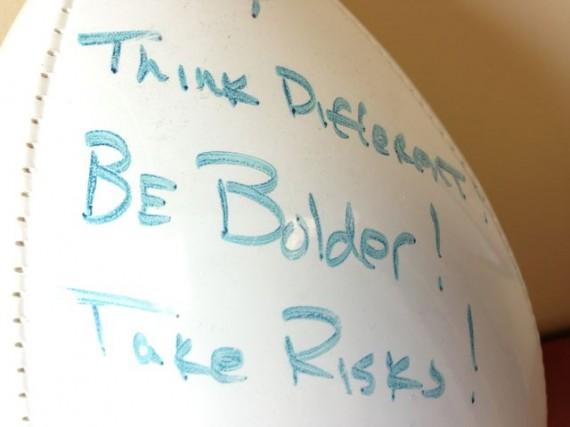 Inspirational message written of souvenir football