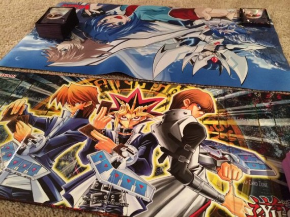 YuGioh mats set on Family room floor for the match to begin