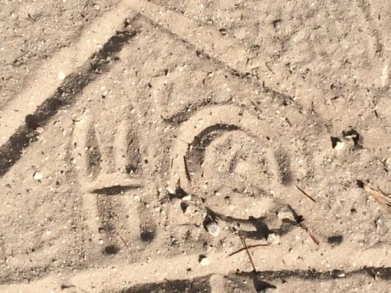 Mid Life Celebration logo drawn in sand