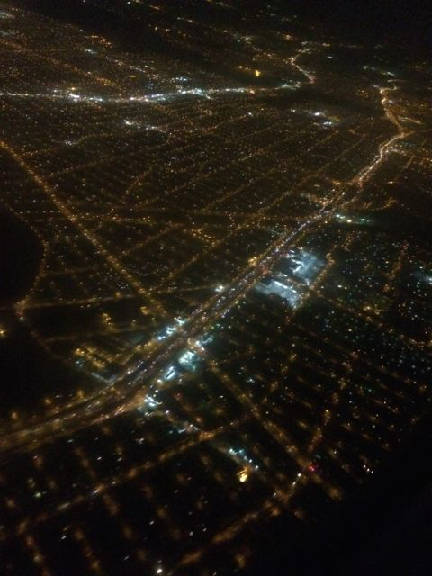City at night from Delta Connection flight