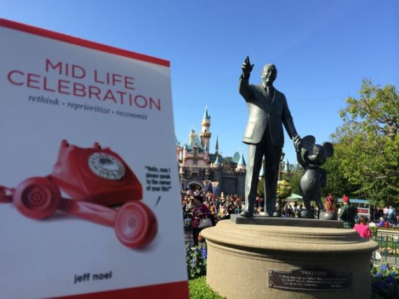 Midlife Celebration the book by Disneyland's partners statue