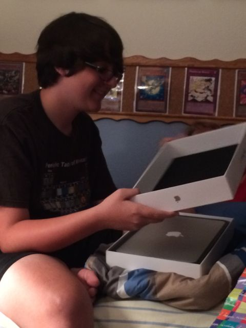 Teen receiving MacBook Air for birthday