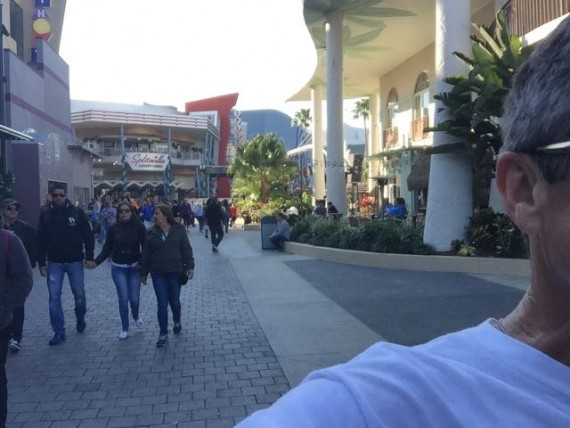 Disney Speaker jeff noel running through Downtown Disney