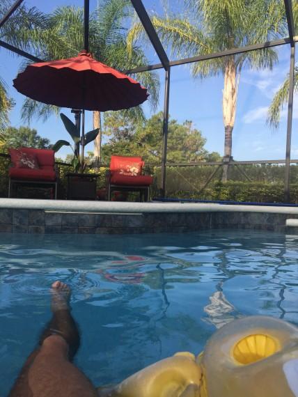 Floating in a pool raft near Disney World