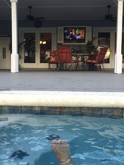 Watching tv from Florida pool
