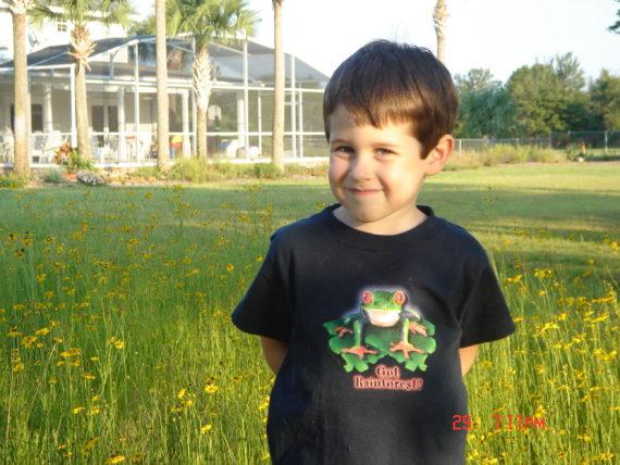 five year old in backyard