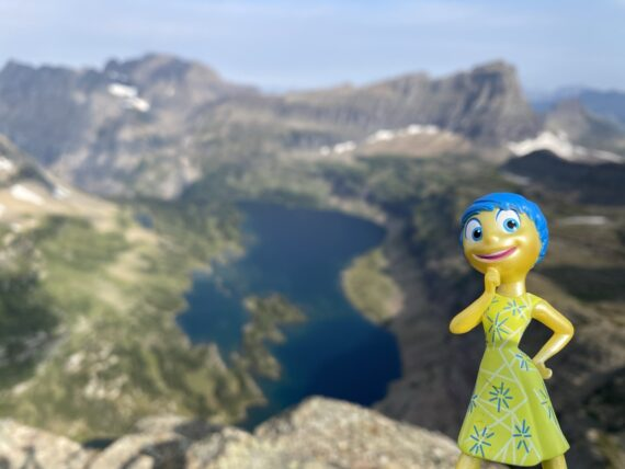 Pixar character figurine in mountains