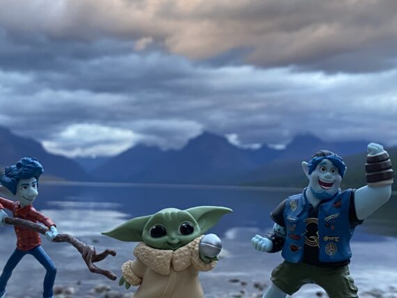 Pixar Onward toys and toy baby yoda by mountain lake