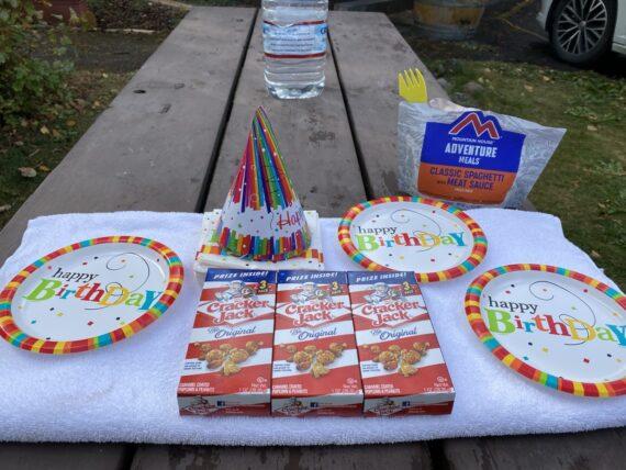 birthday party setup on picnic table