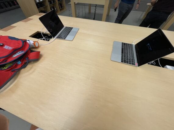 Two MacBooks on a large table