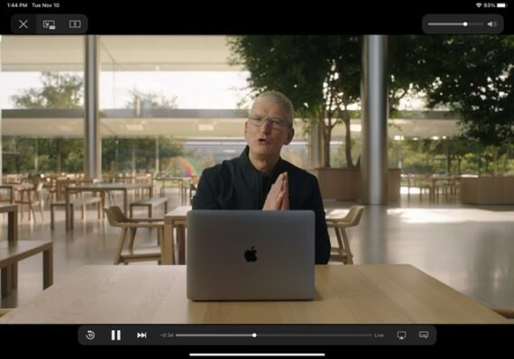 Tom Cook sitting at a desk with a MacBook