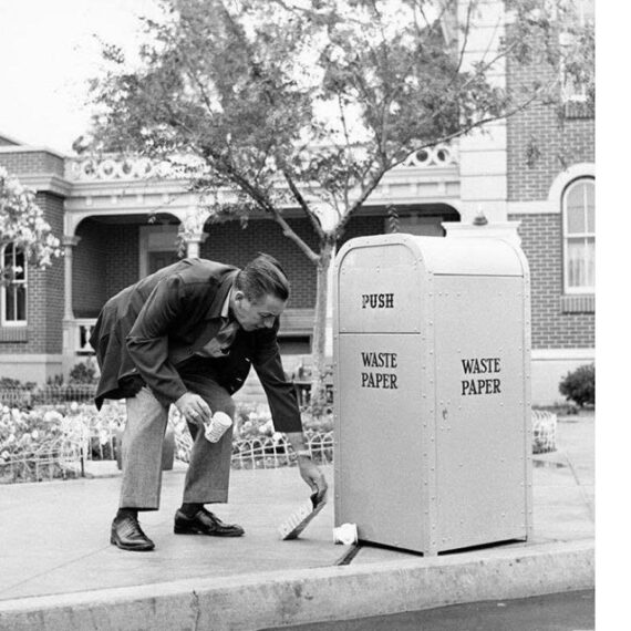 classic photo of Walt Disney picking up trash