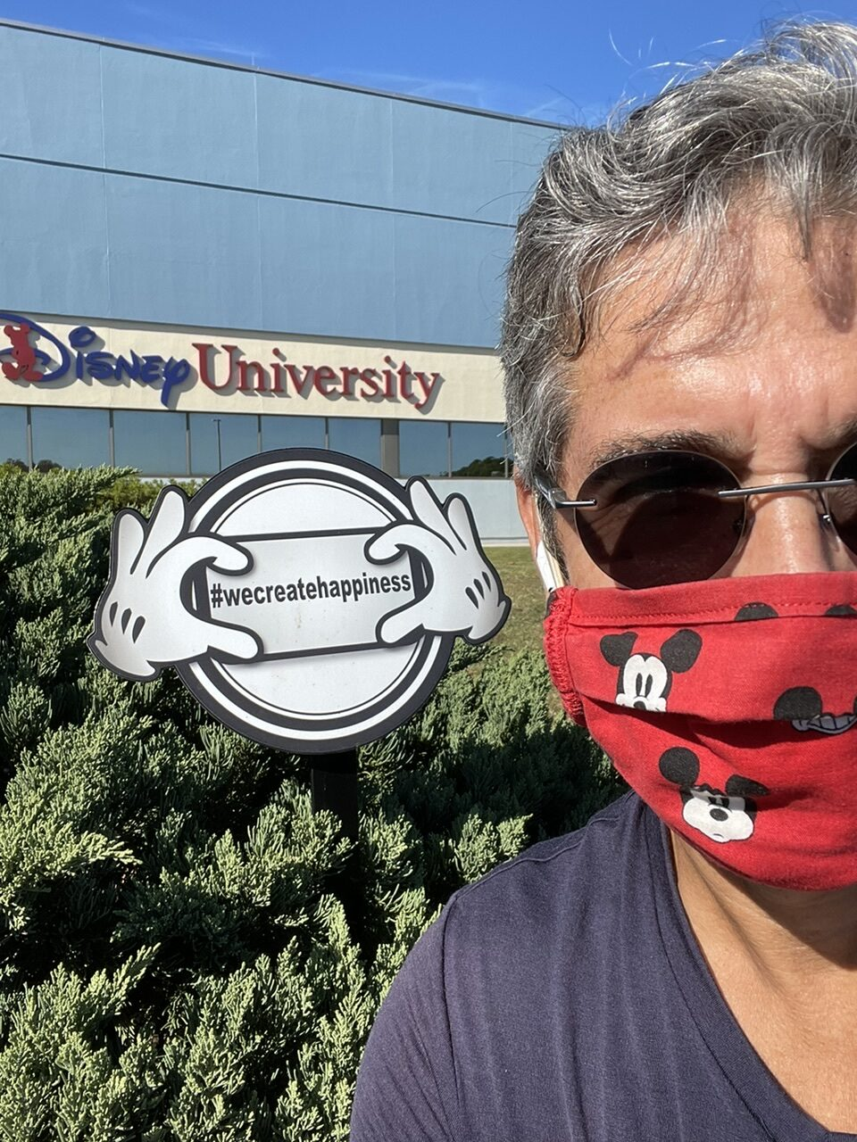 Man with Mickey Mouse face mask at Disney University