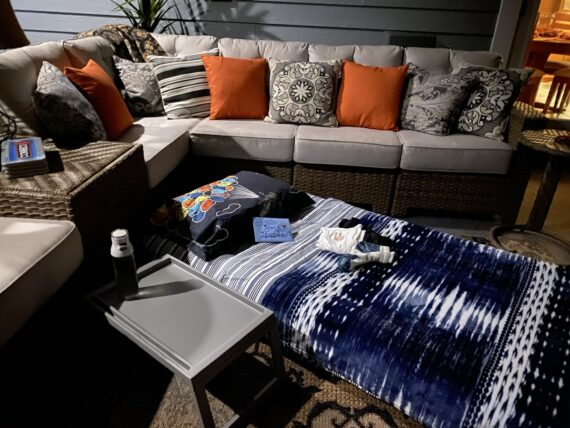 Air mattress bed next to the patio furniture