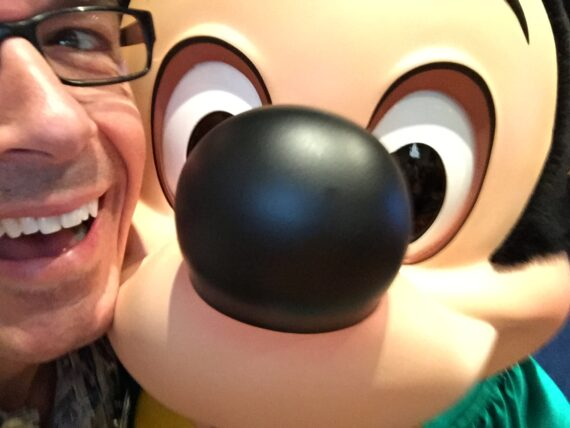 Close up of Mickey Mouse with a man next to him