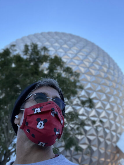 Man in a mask in front of spaceship Earth