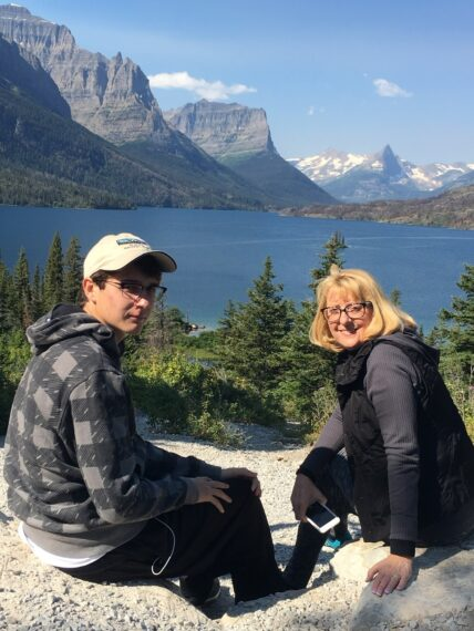 mom and son in mountains