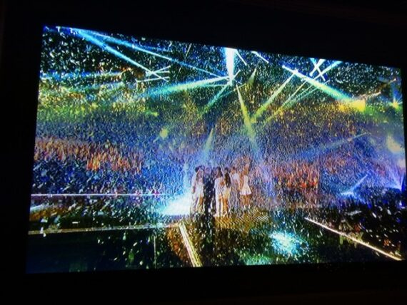 stage filled with falling confetti