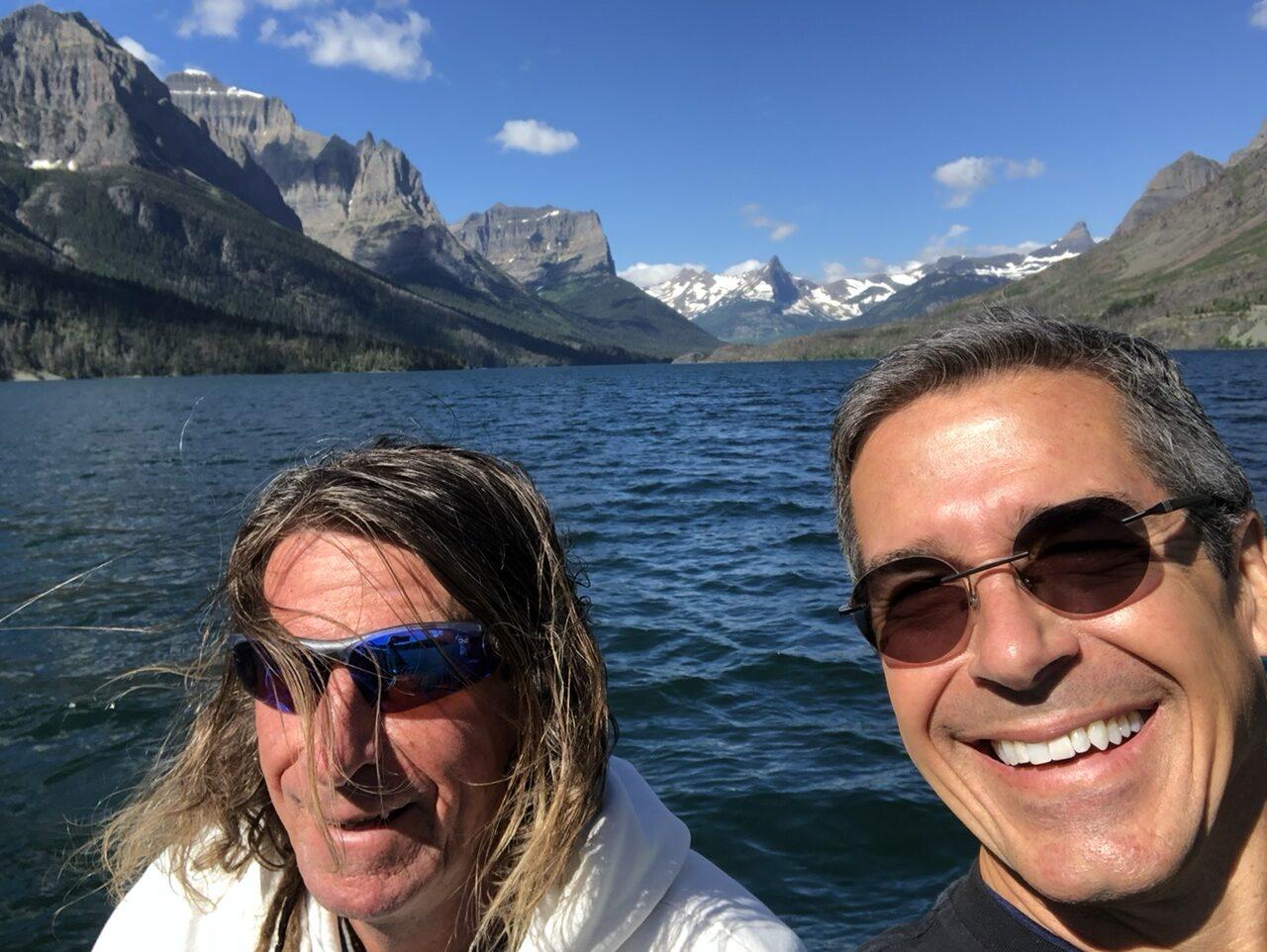 two men on a mountain lake boat
