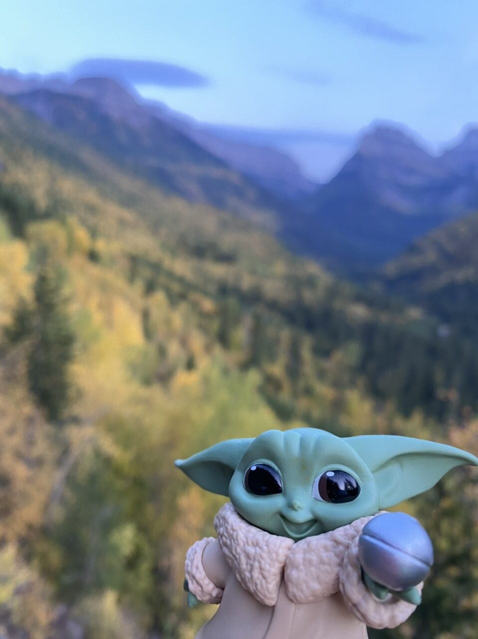Baby Yoda toy in mountains