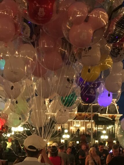 Balloons for sale on Main Street at night