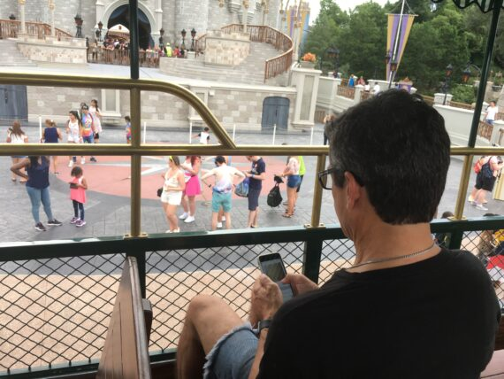 man on phone on Disney Omni bus