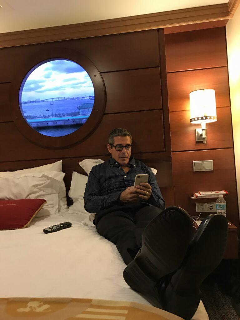 Disney business author Jeff Noel writing in Disney Cruise Ship stateroom