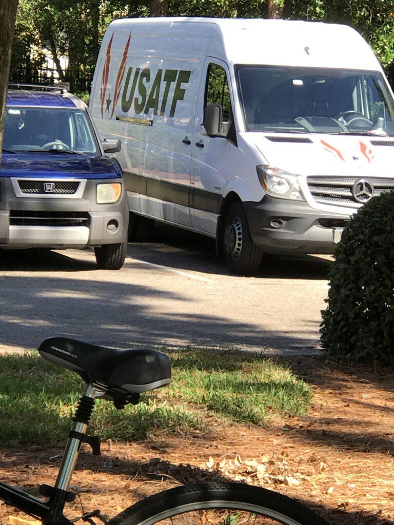 Bicycle parked near USATF van