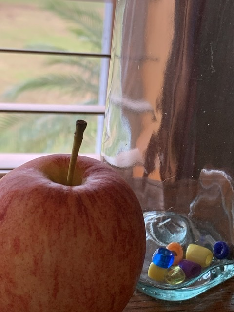 apple next to glass jar